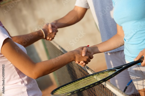 Shaking hands on tennis court