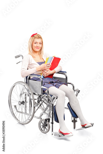A smiling young girl in a wheelchair