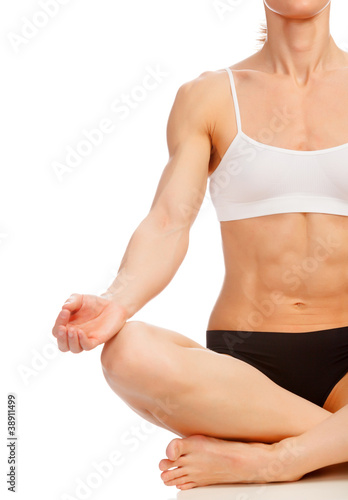 Muscular woman doing yoga exercise, isolated on white background