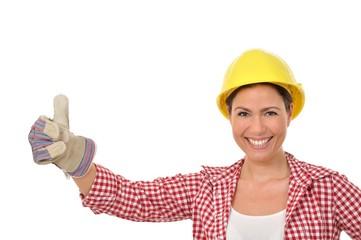 Handwerkerin mit Handschuh hält einen Daumen seitlich hoch