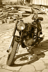Retro motorcycle in court yard