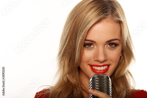 Smiling Woman Holding Microphone