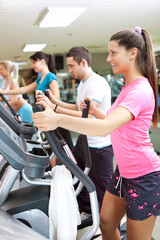 young healthy people exercising in gym