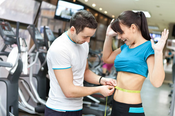 woman in gym surprised with results
