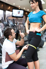 trainer with female client checking results