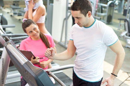 female trainer with man on  treadmill