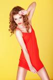 Beautiful girl in short red dress