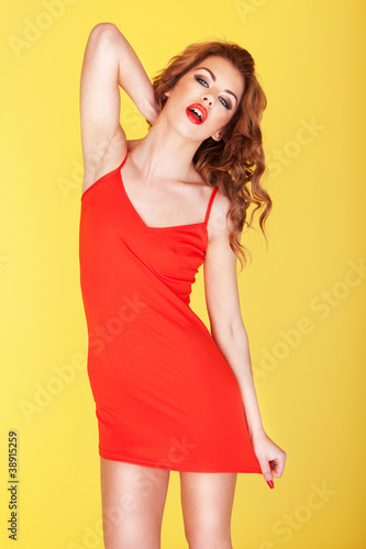 Slender young girl in red dress