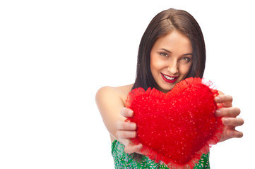 Cute young woman holds a heart  isolated on white background
