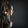 Inspired woman with cello. Cellist profile