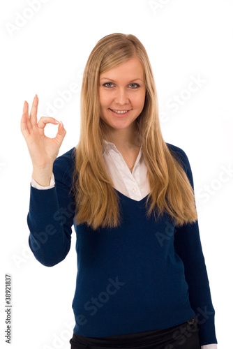 Business woman signaling ok - isolated over white