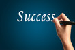 "Male Hand Write the Word ""Success"""