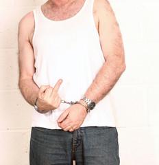 Man with attitude in handcuffs