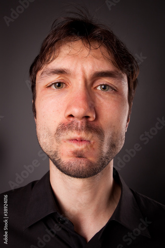 closeup portrait of grimacing man