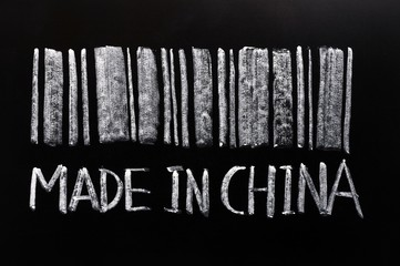 """Bar code of """"Made in China""""written with chalk on a blackboard"""