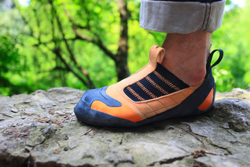 Closeup image of rock climber's foot in climbing shoe