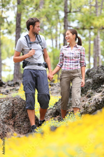 Hiking couple walking in forest