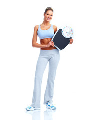 Fitness woman with scales.