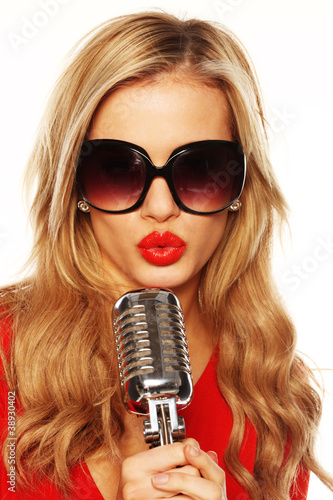 Gorgeous Blonde In Sunglasses With Microphone