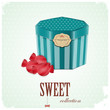 vintage postcard - box and sweet candy on blue background