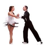 Fototapety young couple dancimg salsa