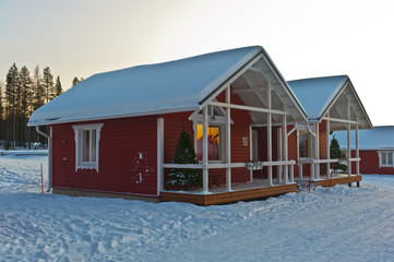 wooden house in Lapland in winter landscape