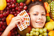 Woman with fruit and vitamin pill.