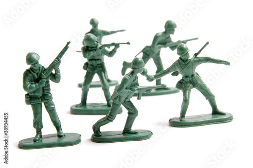 Green toy army engaged in battle