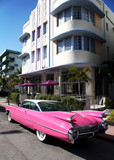 Old american car parked on Collins Avenue Miami Beach