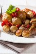 Rustic meat dish with oven baked vegetables and mushrooms