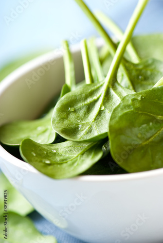 Closeup of fresh baby spinach in a bowl