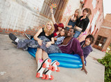 Fun loving group of crazy teen punks sit in a blue inflateable p