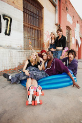 Fun loving group of teen punks sit in an inflatable pool