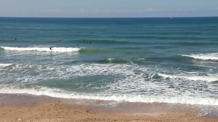 Sea and young surfers