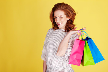 Happy Shopper With Colourful Bags