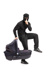 Man in robbery mask holding a carrycot