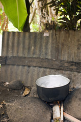 outdoor natural stove with food cooking Corn Island Nicaragua
