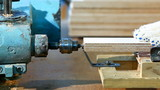 Drilling a plywood from side at wood factory poster