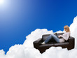 woman relaxing with laptop in couch on the cloud