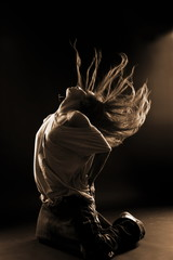 cool woman dancer against black background