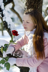 woman and rose in winter park
