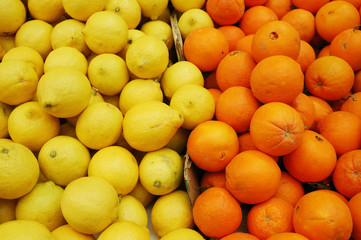 lemons and clementine on market stand