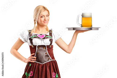 Woman in traditional costume holding a tray with beer glass