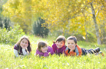 A group of children laying down in the grass