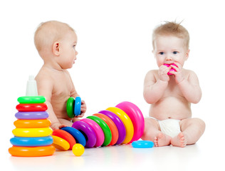 children playing with color developmental toys