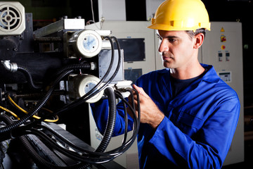 industrial machine operator working on machine