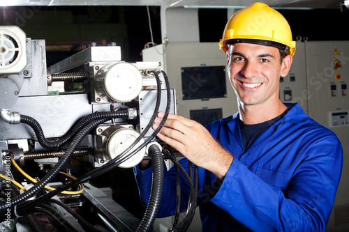 happy industrial machine operator at work