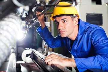 modern machine operator working in factory