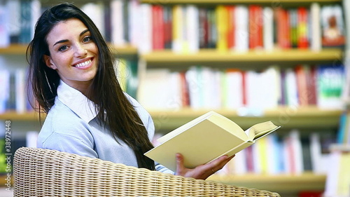 smiling female student with book