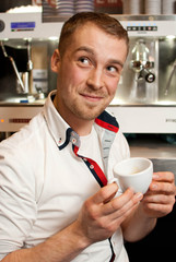 Barista with cup